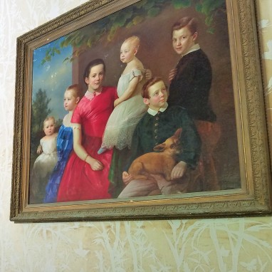 The girl in red is believed to be the young portrait of Annie Palmer, while the other children were added because she doesn't like children.